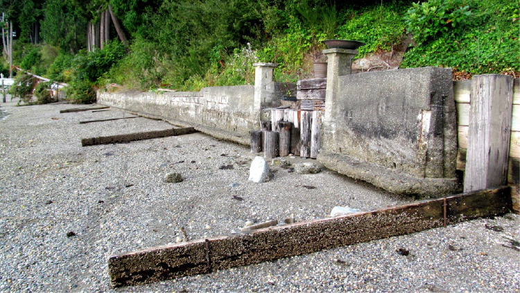 Old concrete and wood bulkhead on a Washington shoreline